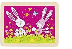 two cartoon bunnies with vibrant pink background and bright green meadow