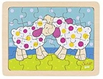 two cartoon sheep nuzzle in the meadow