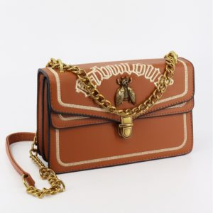 """camel coloured small square purse with """"fabulous"""" embroidered on it"""