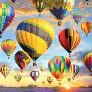 balloons in flight in sunrise