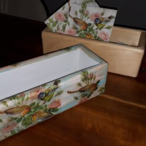 unfinished wooden box shown after decoupaging