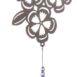 Crystal - Blooming Month Violets - February   Round crystal hangs from a silver flower with cut-out details and beads.