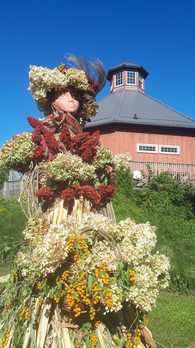 Corn queen in front of Crazy 8 Barn & Garden